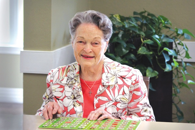 Mary Pease plays bingo at The Oaks