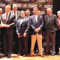 Caption: Heard, McElroy and Vestal award the J. Pat Beaird Industry of the Year for 2019