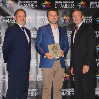 Caption: Jay Covington, 318 Forum's Top Biz recipient Jared Beville of Red River Brewing and Chamber Chairman, Patrick Harrison